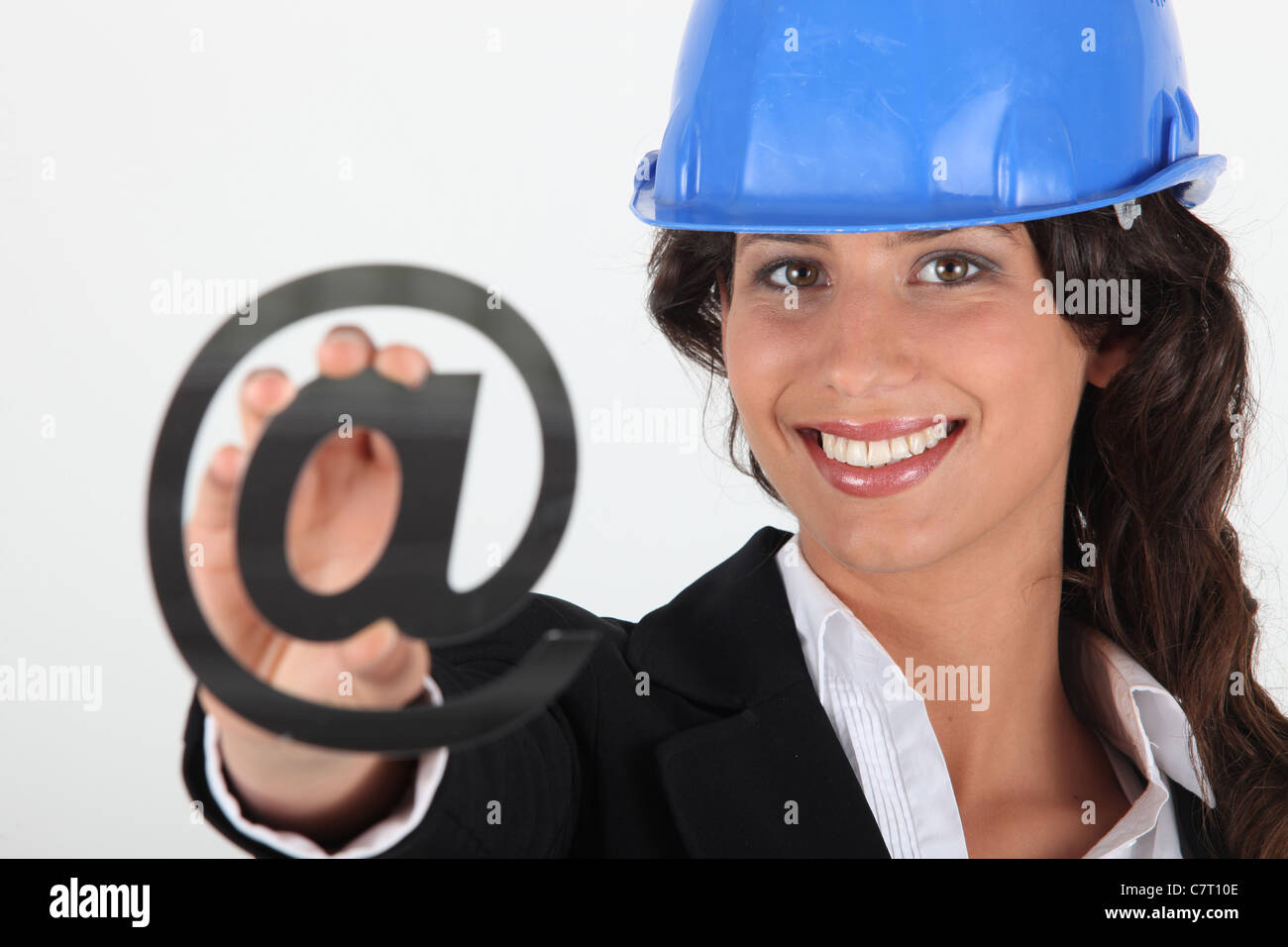 Brunette holding at symbol - Stock Image