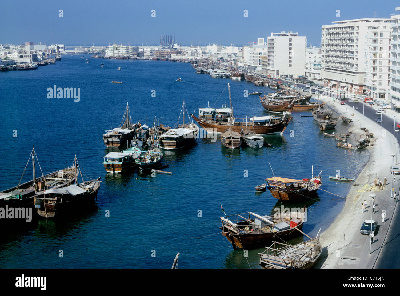 High view of dhows on Dubai Creek, Deira side 1974 - Stock Image
