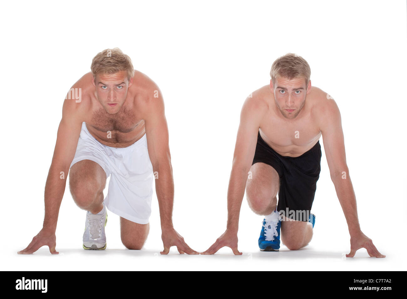 two sprinters getting ready to start the race - isolated on white - Stock Image