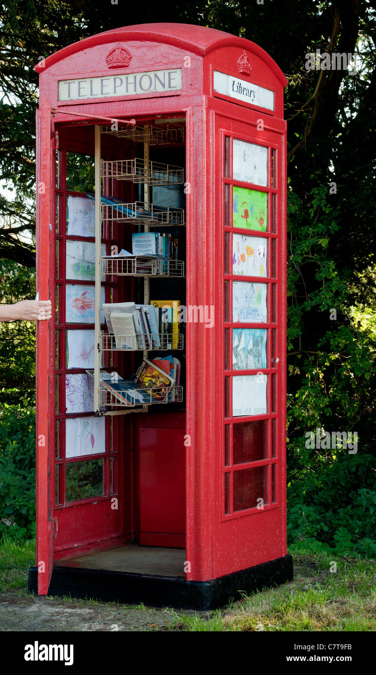 Disconnected British telephone kiosk re-used as village library (book exchange) on the B3046 at Brown Candover, - Stock Image