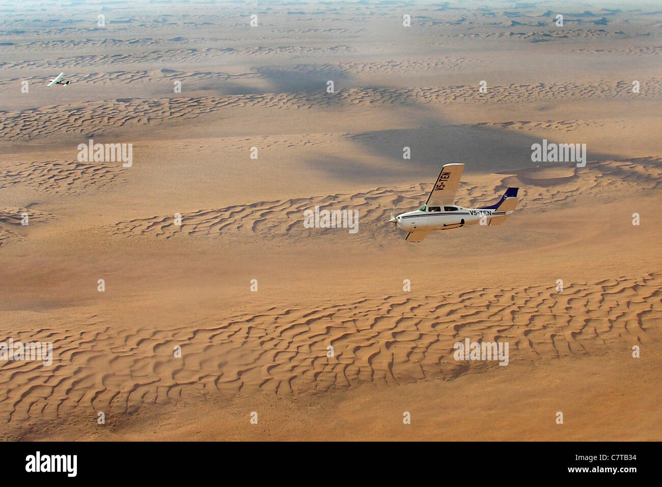 Africa, Namibia, aerial view of the desert and Cessna 210 airplane - Stock Image