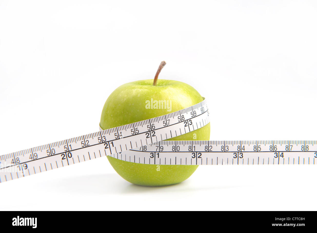 Green apples measured the meter, sports apples - Stock Image