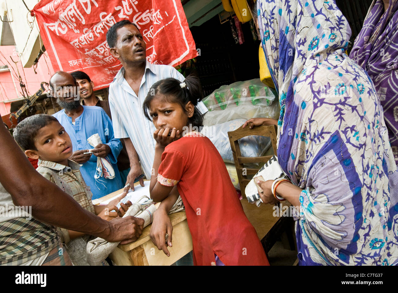 Bangladesh, women waiting to buy rice - Stock Image