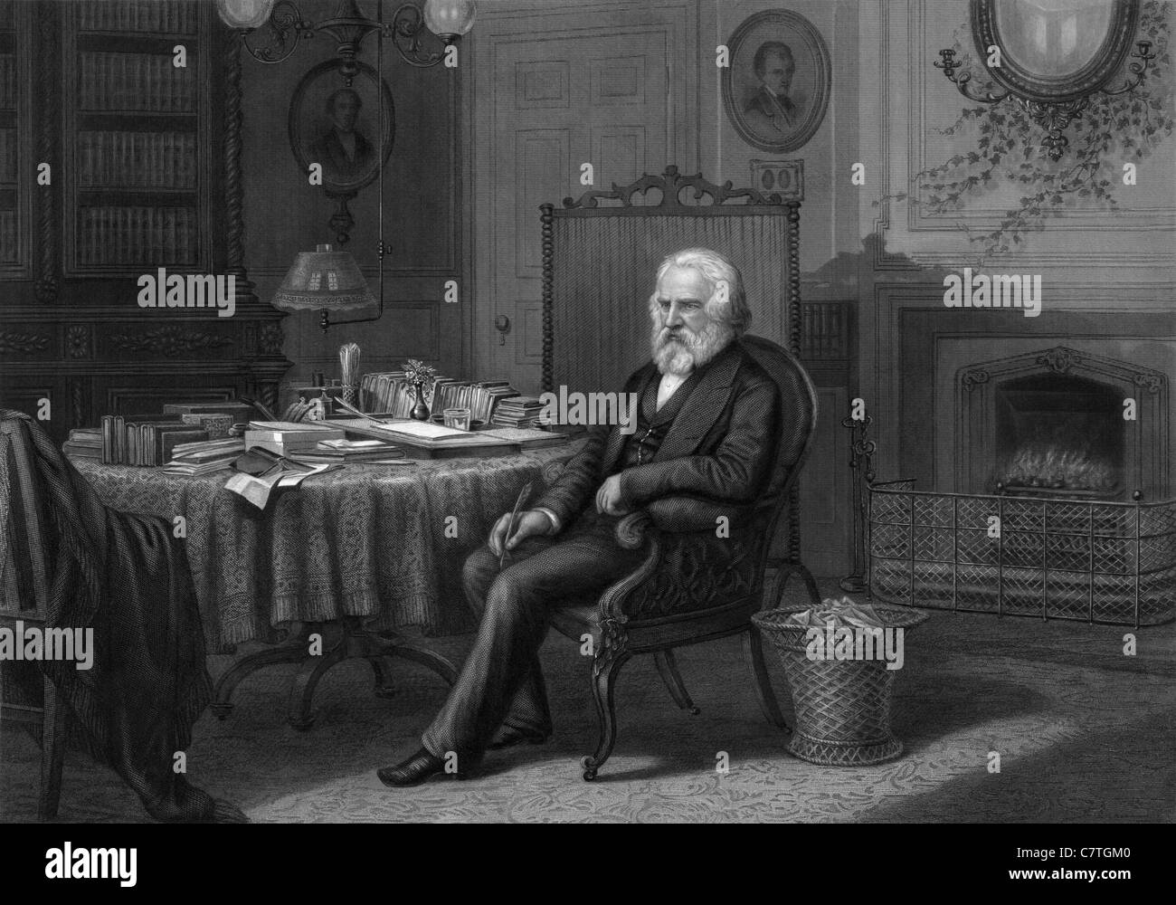 Vintage portrait engraving circa 1880s of American poet and educator Henry Wadsworth Longfellow (1807 - 1882) sitting - Stock Image