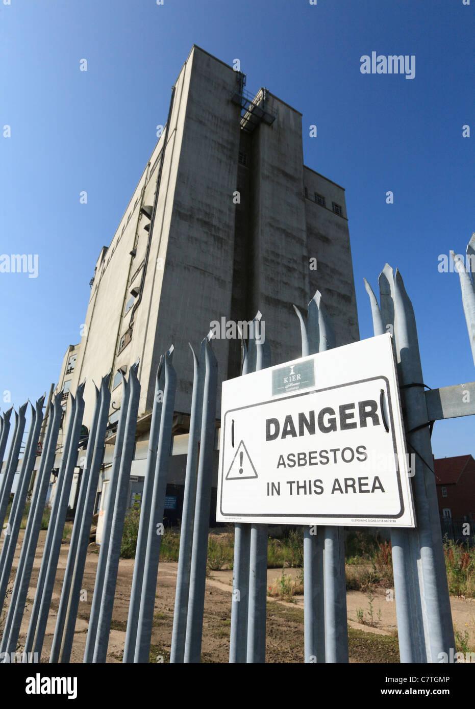 Asbestos danger warning sign outside the derelict Louth Malt Kiln building. - Stock Image