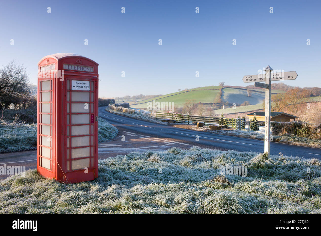Traditional English telephone box in the frost at Stockleigh Pomeroy, Devon, England. December 2008 - Stock Image