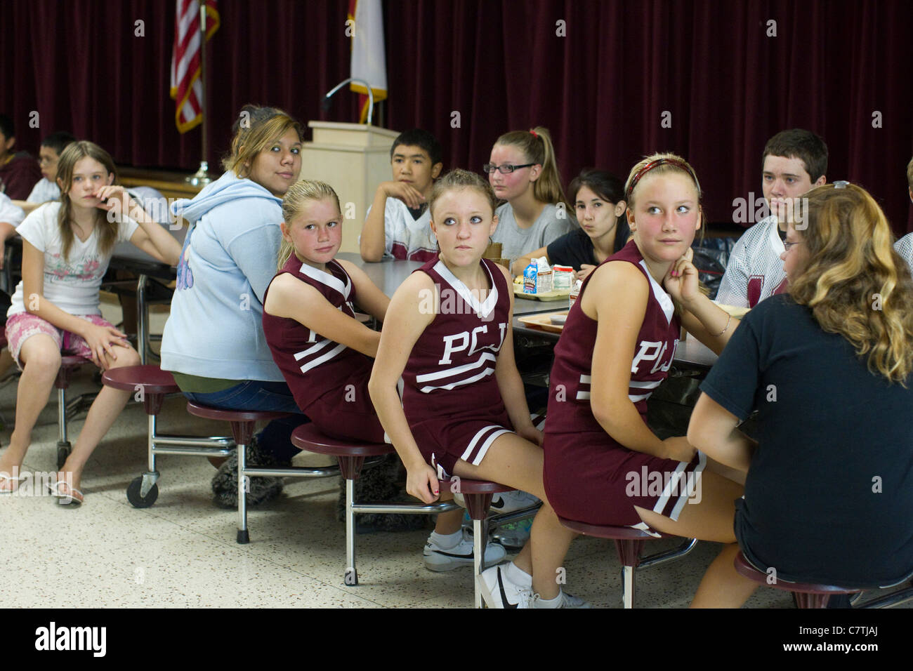 Junior high students in the Paint Creek, TX schools listen to morning announcements from their teacher in the school's - Stock Image