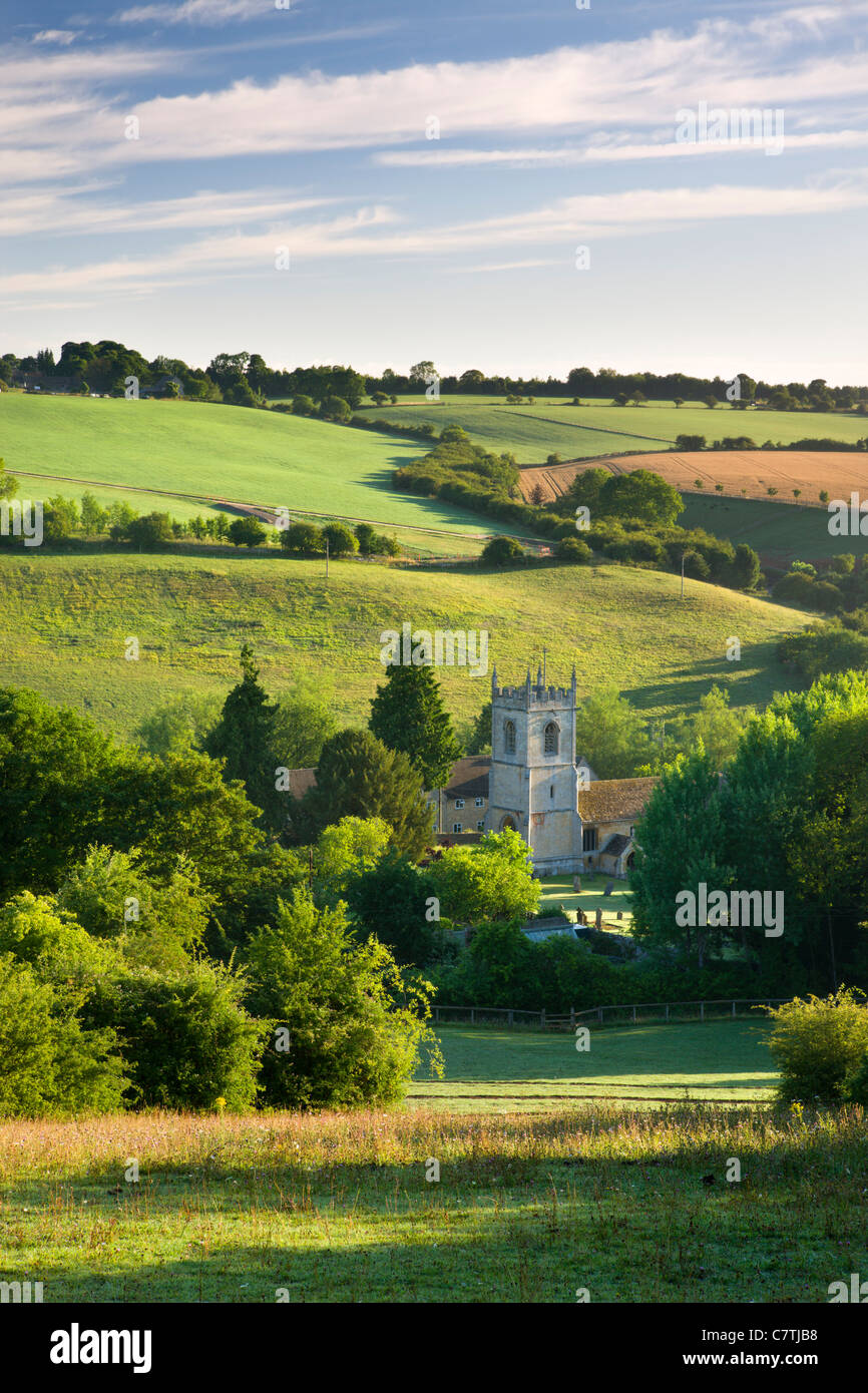 Naunton church, nestled in the beautiful rolling Cotswolds countryside, Gloucestershire, England. Summer (July) - Stock Image