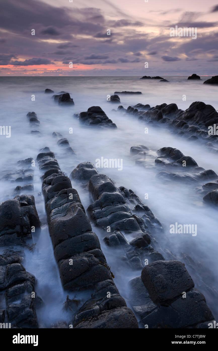 Rock ledges at Hartland Quay at sunset, Hartland, Devon, England. Autumn (September) 2010. - Stock Image