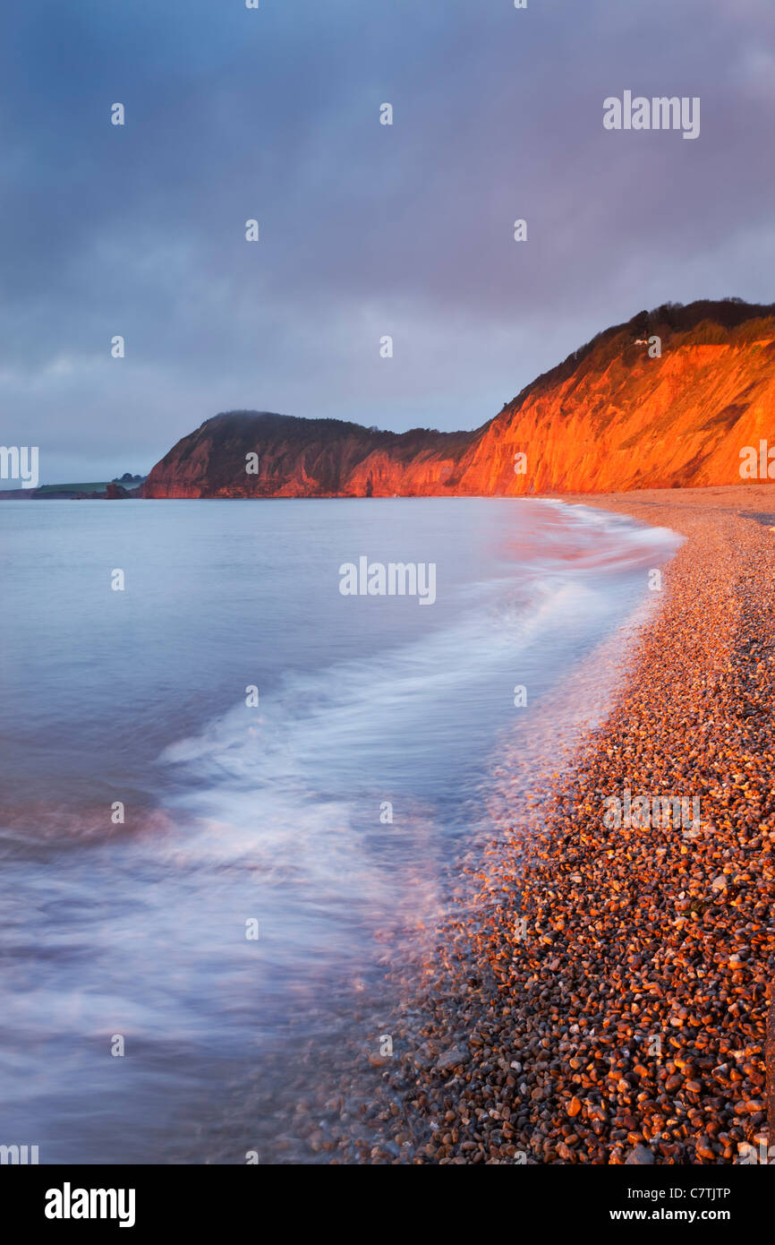 Burning red cliffs at Sidmouth on the Jurassic Coast, Devon, England. Winter (February) 2011. - Stock Image