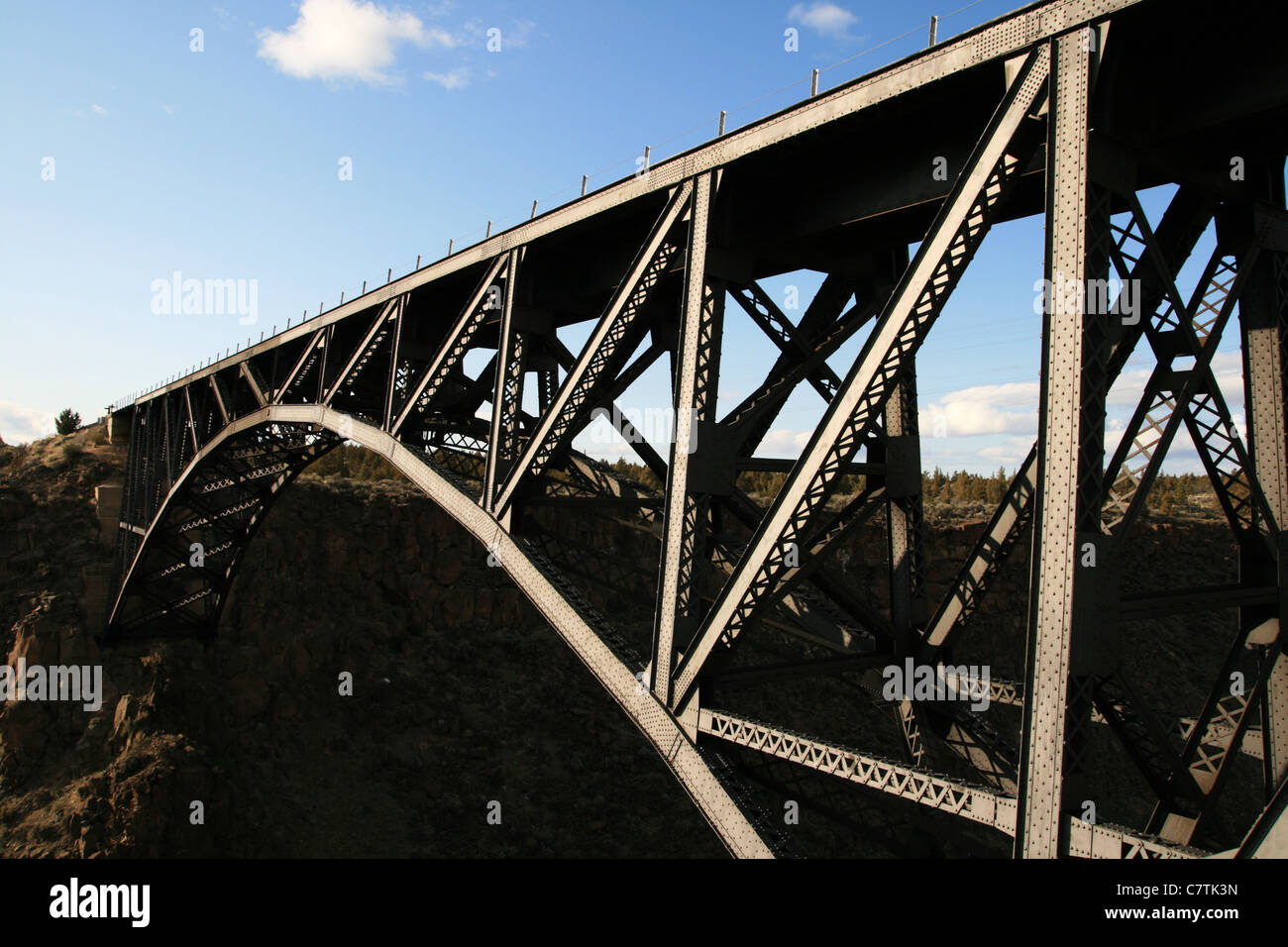 steel railroad bridge over the Crooked River in central Oregon Stock Photo