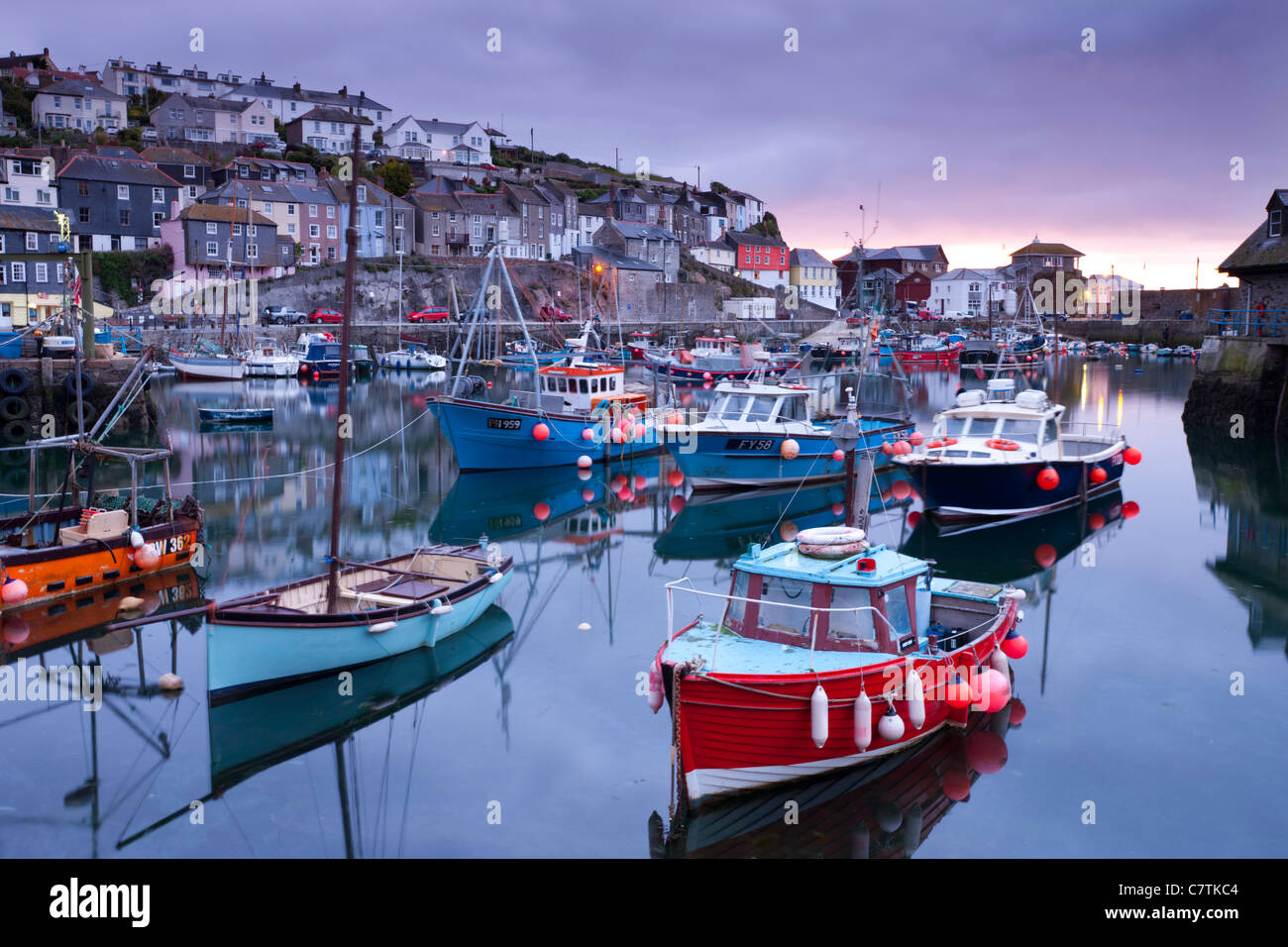 Sunrise over the picturesque harbour at Mevagissey, Cornwall, England. Spring (May) 2011. - Stock Image
