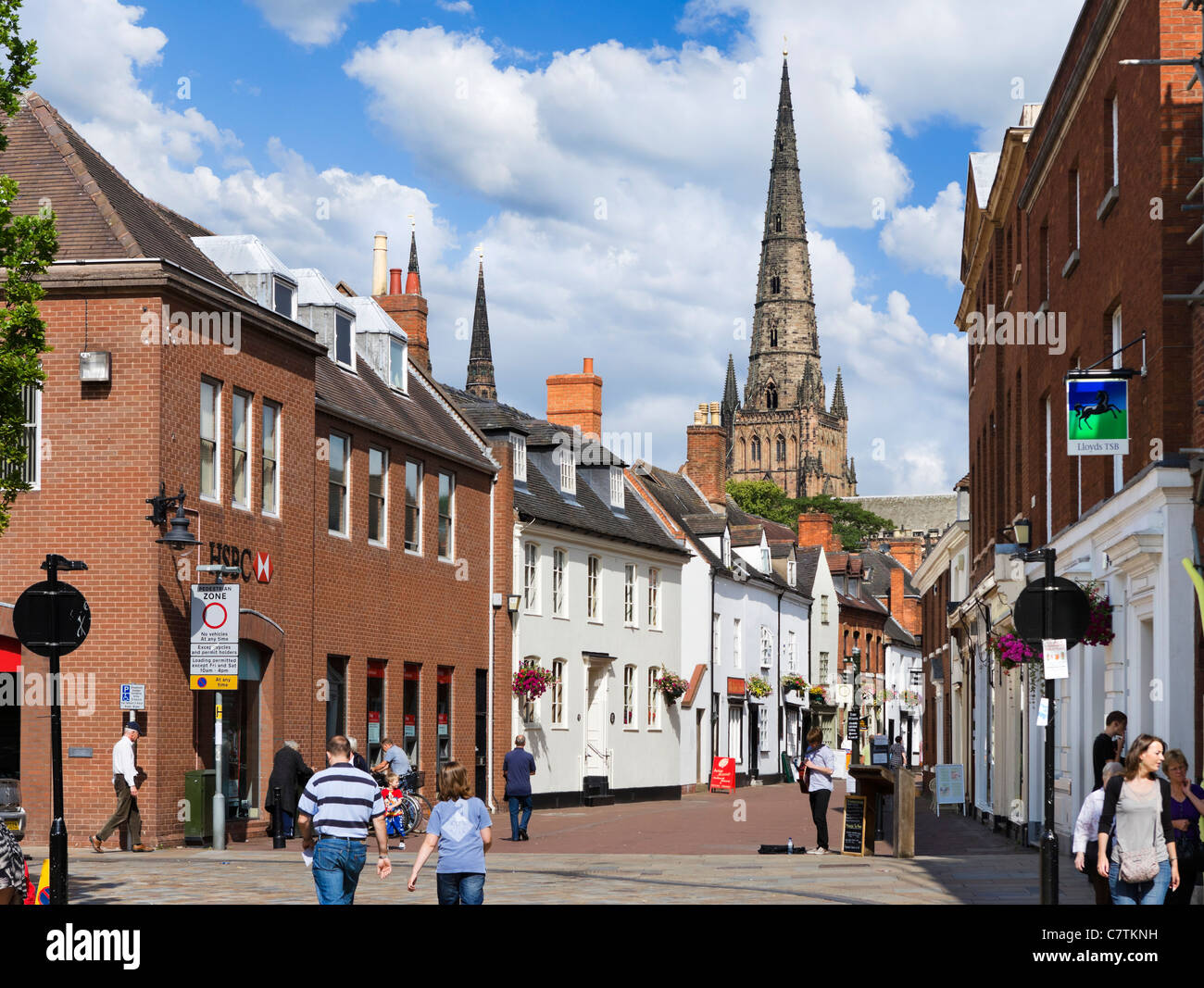 Spire of Lichfield Cathedral from Bakers Lane in the city centre, Lichfield, Staffordshire, England, UK - Stock Image