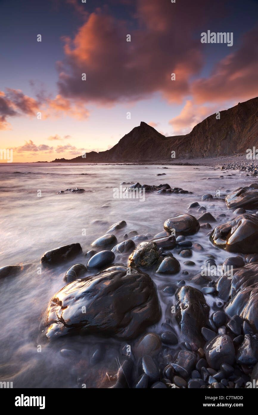 Sunset on the shoreline of Speke's Mill Mouth beach in North Devon, England. Summer (June) 2011. - Stock Image
