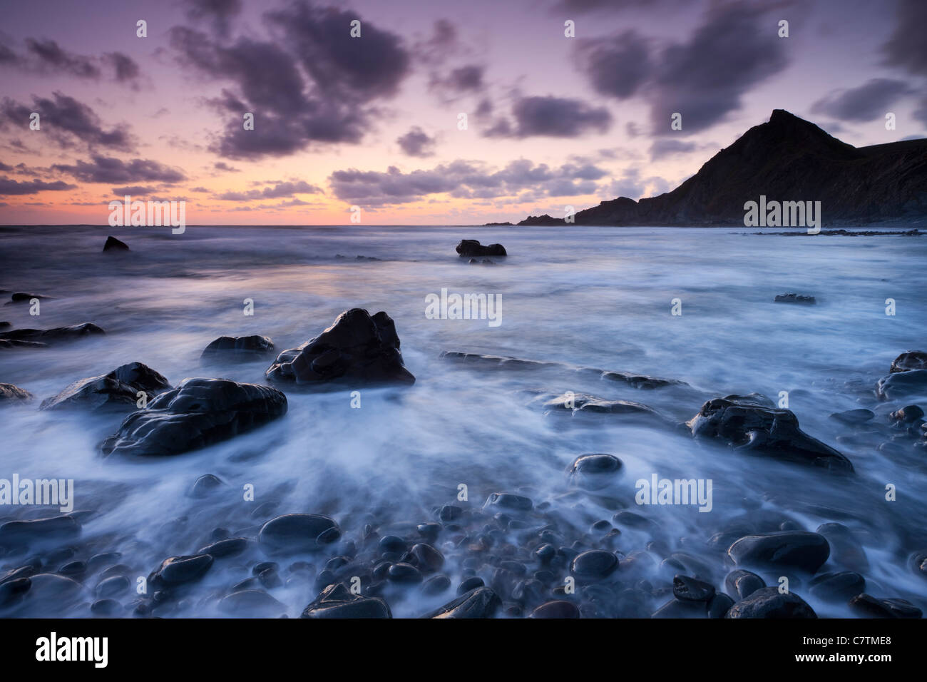 Dusk on the rocky shores of Speke's Mill Mouth in North Devon, England. Summer (June) 2011. - Stock Image