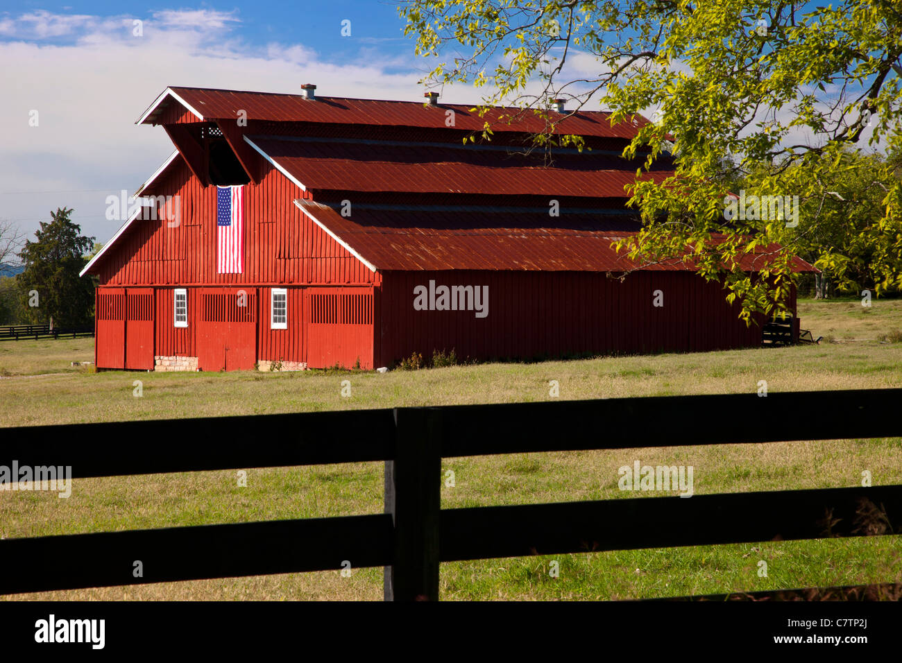 Red barn with American flag near Franklin Tennessee USA Stock Photo