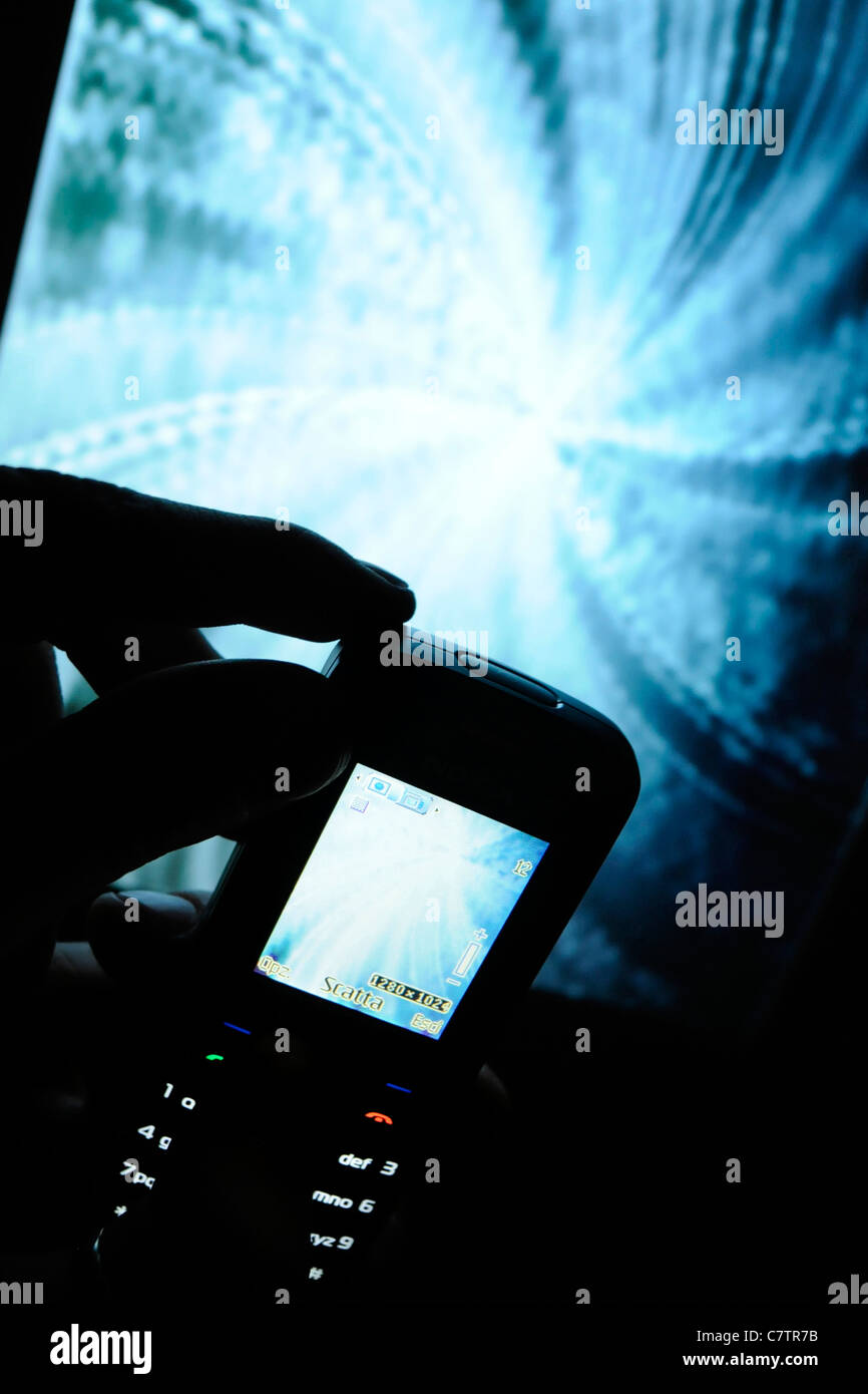 Mobile phone with digital camera - Stock Image