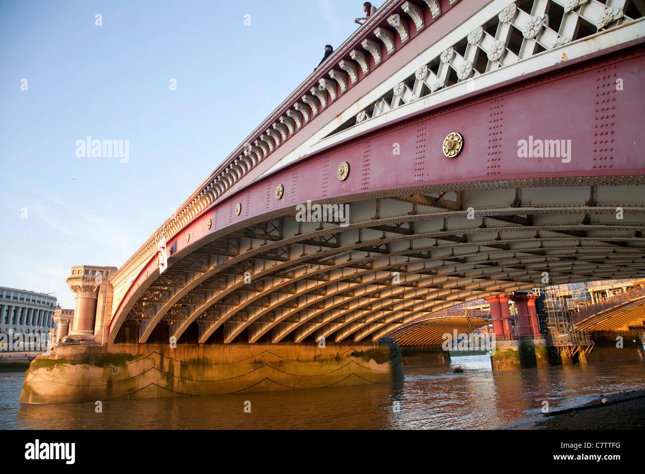Blackfriars bridge London. Crossing the river Thames. - Stock Image