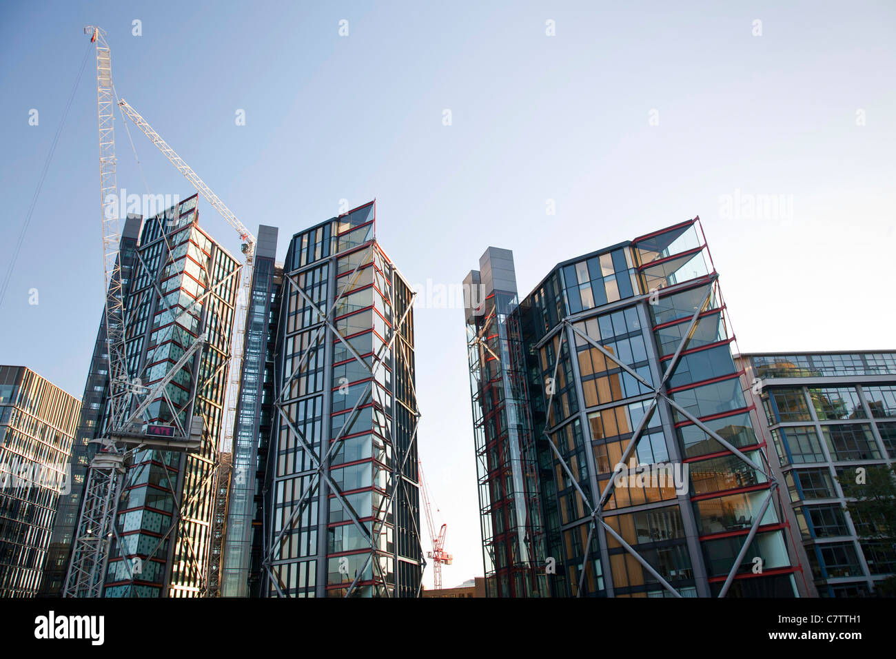 Modern skyscrapers under construction behind Tate Modern London. - Stock Image