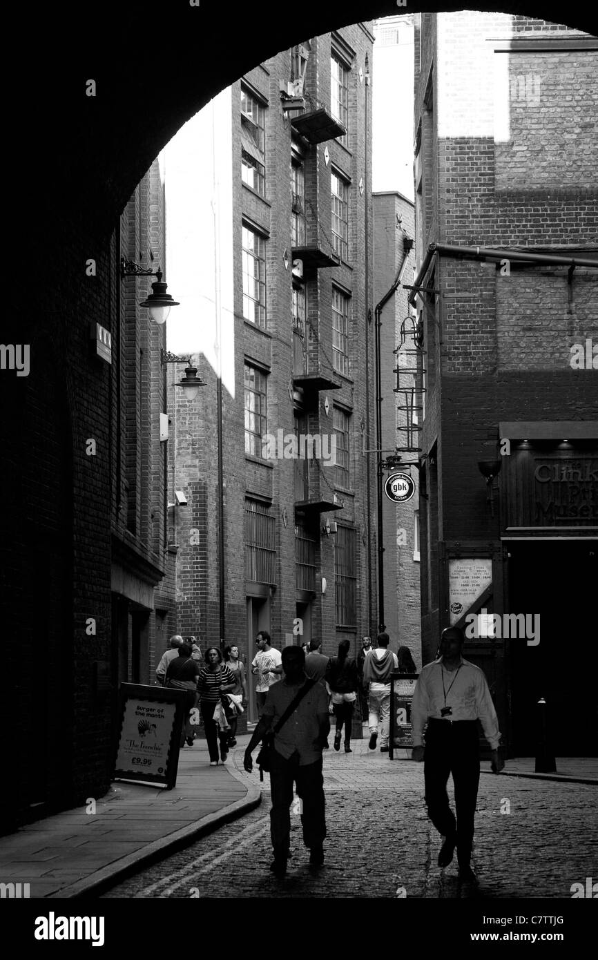 Clink street London, Clink prison and tall warehouses - Stock Image