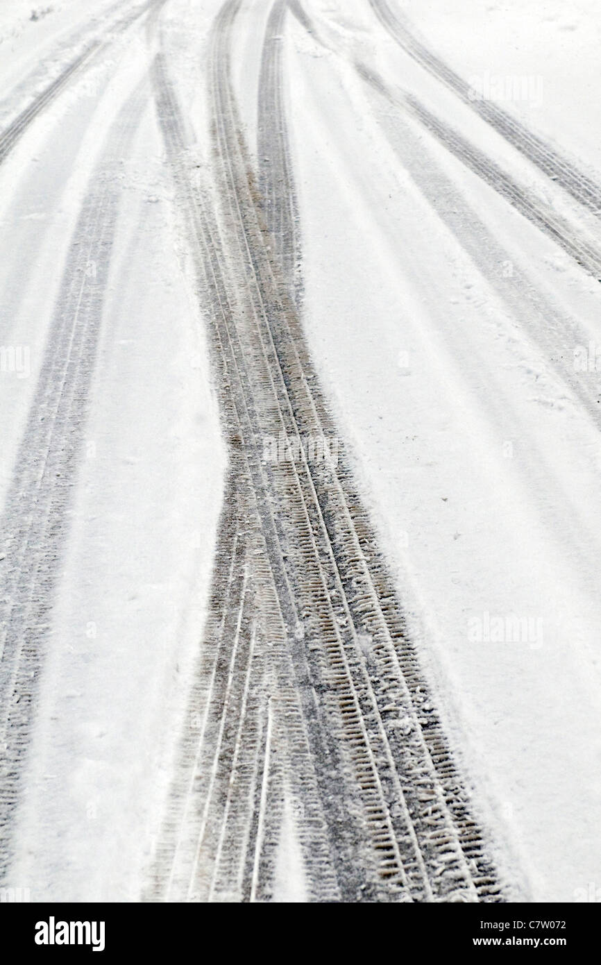 Tire tracks in snow - Stock Image