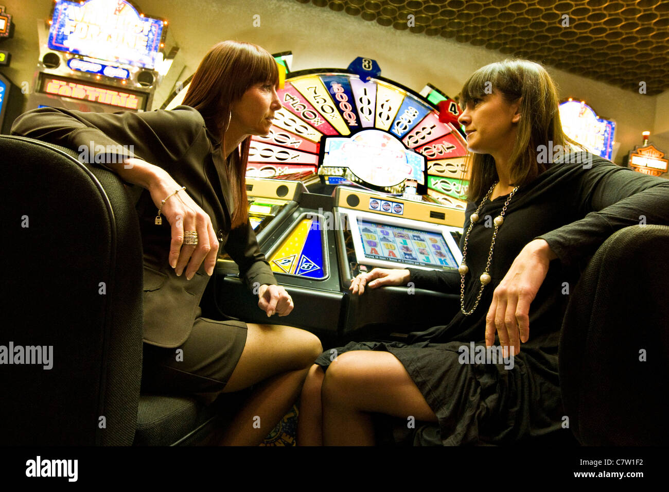 Italy, Val D'Aosta, Saint Vincent, people at slot machine - Stock Image