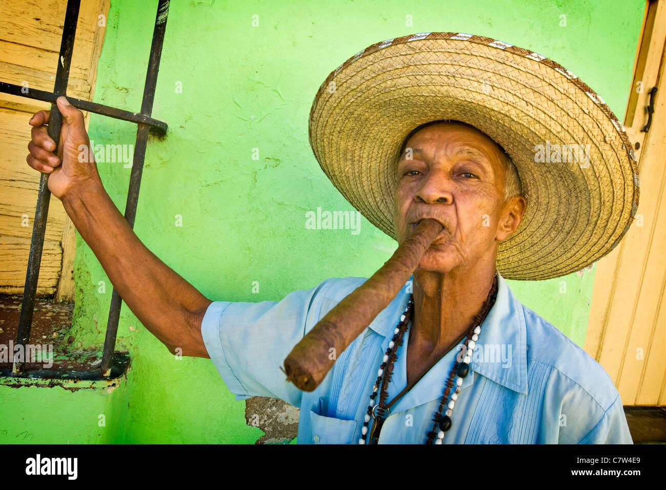 Cuba, Camaguey, man smoking cigar - Stock Image