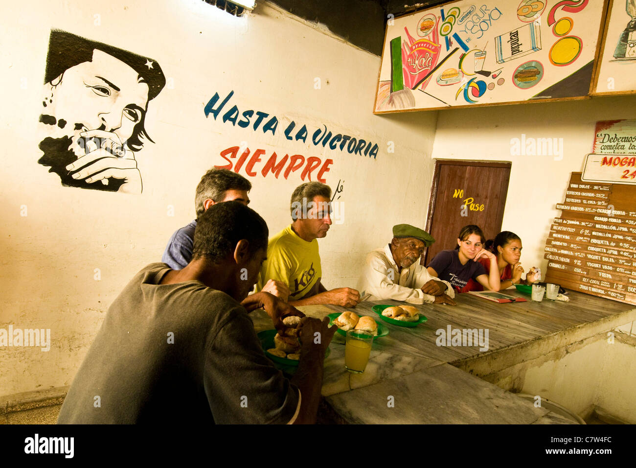 Cuba, Camaguey, people sitting at bar counter - Stock Image