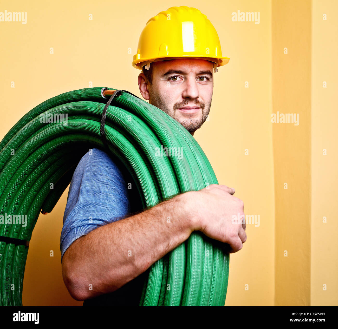 portrait of caucasian manual worker with pipe - Stock Image