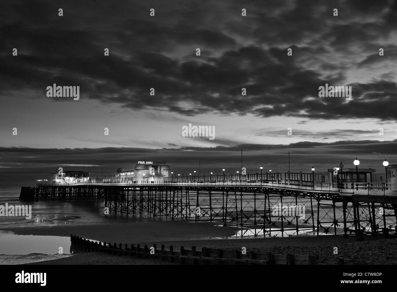 Worthing Pier, West Sussex, Cloudy sky,Black and White Night Time - Stock Image