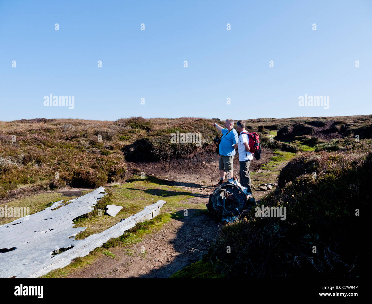 Aircraft Crash Site Stock Photos Images Crashed Beacon Discussing Wreckage On Mill Hill High Peak Derbyshire England Uk