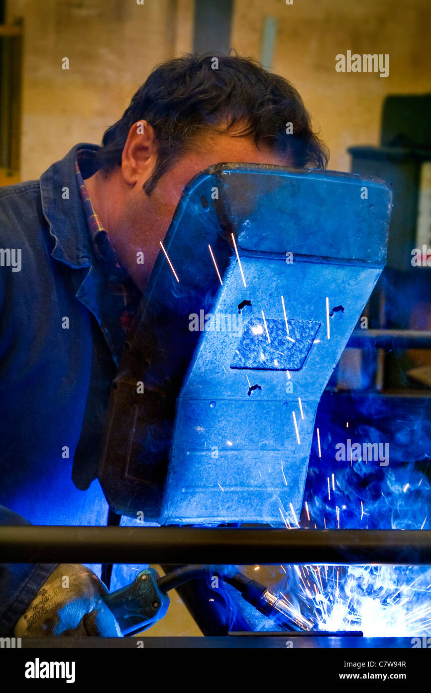 Metal-worker grinding Stock Photo