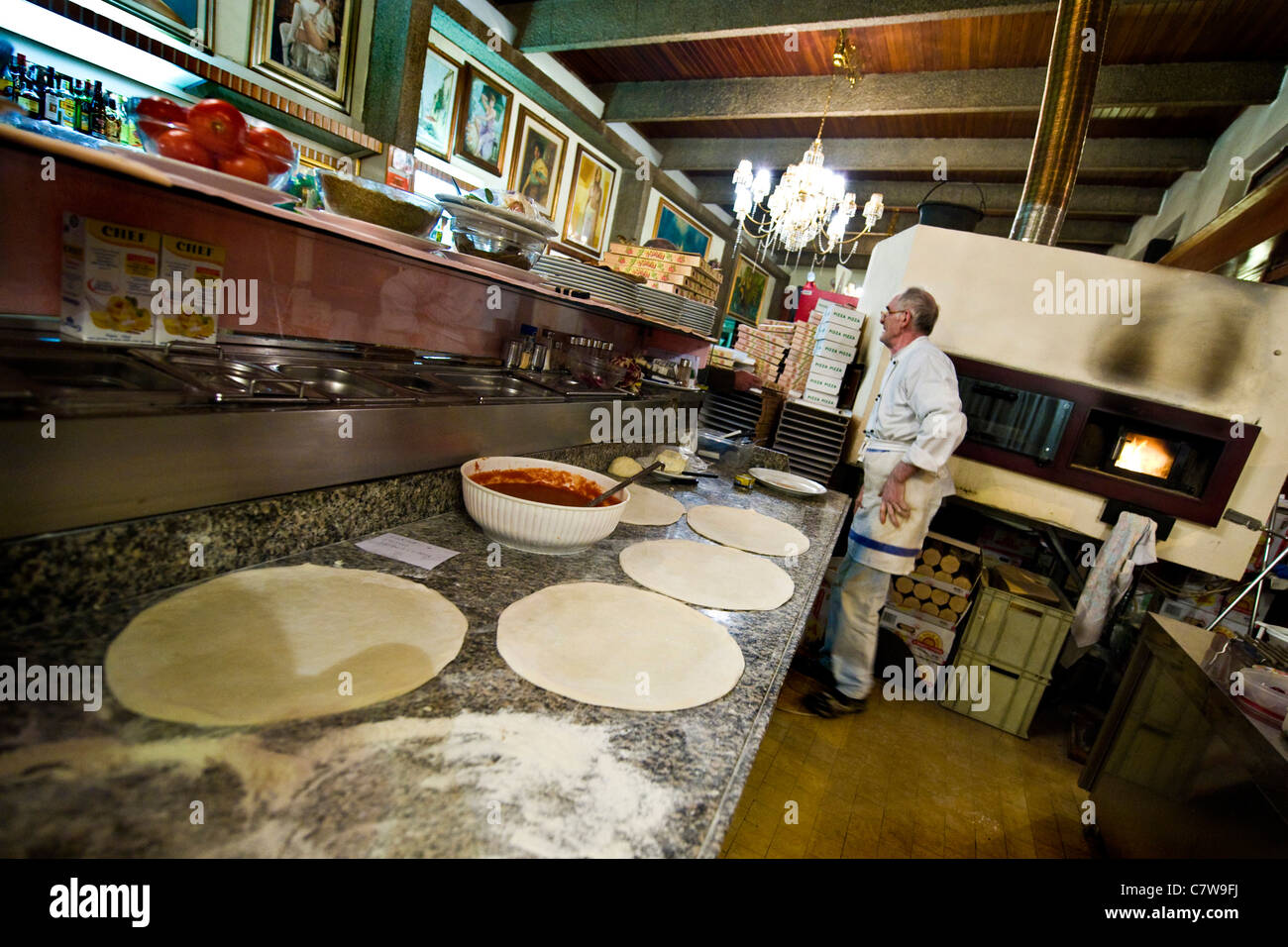 Italy, pizza chef at work Stock Photo