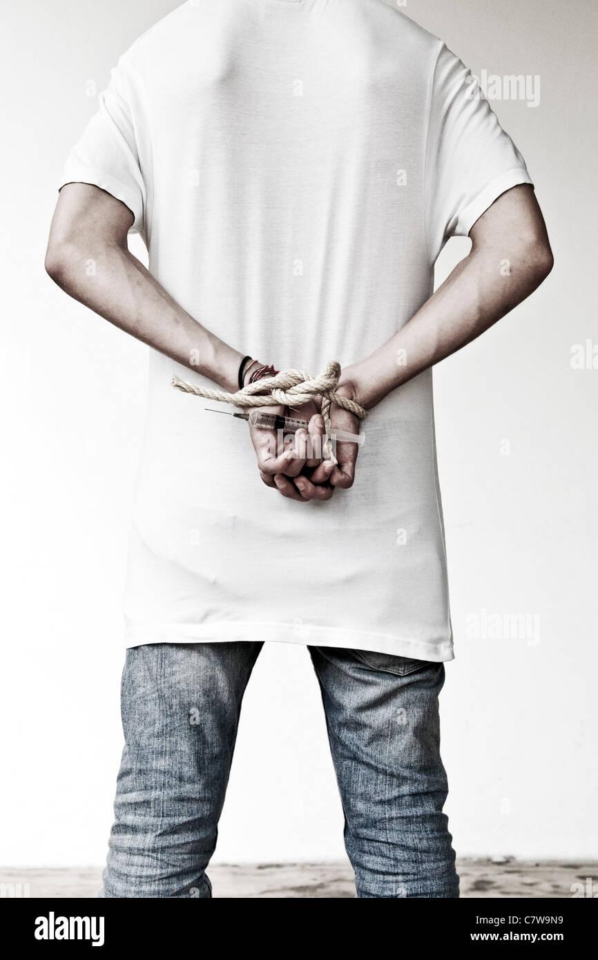 Hand holding syringe Stock Photo