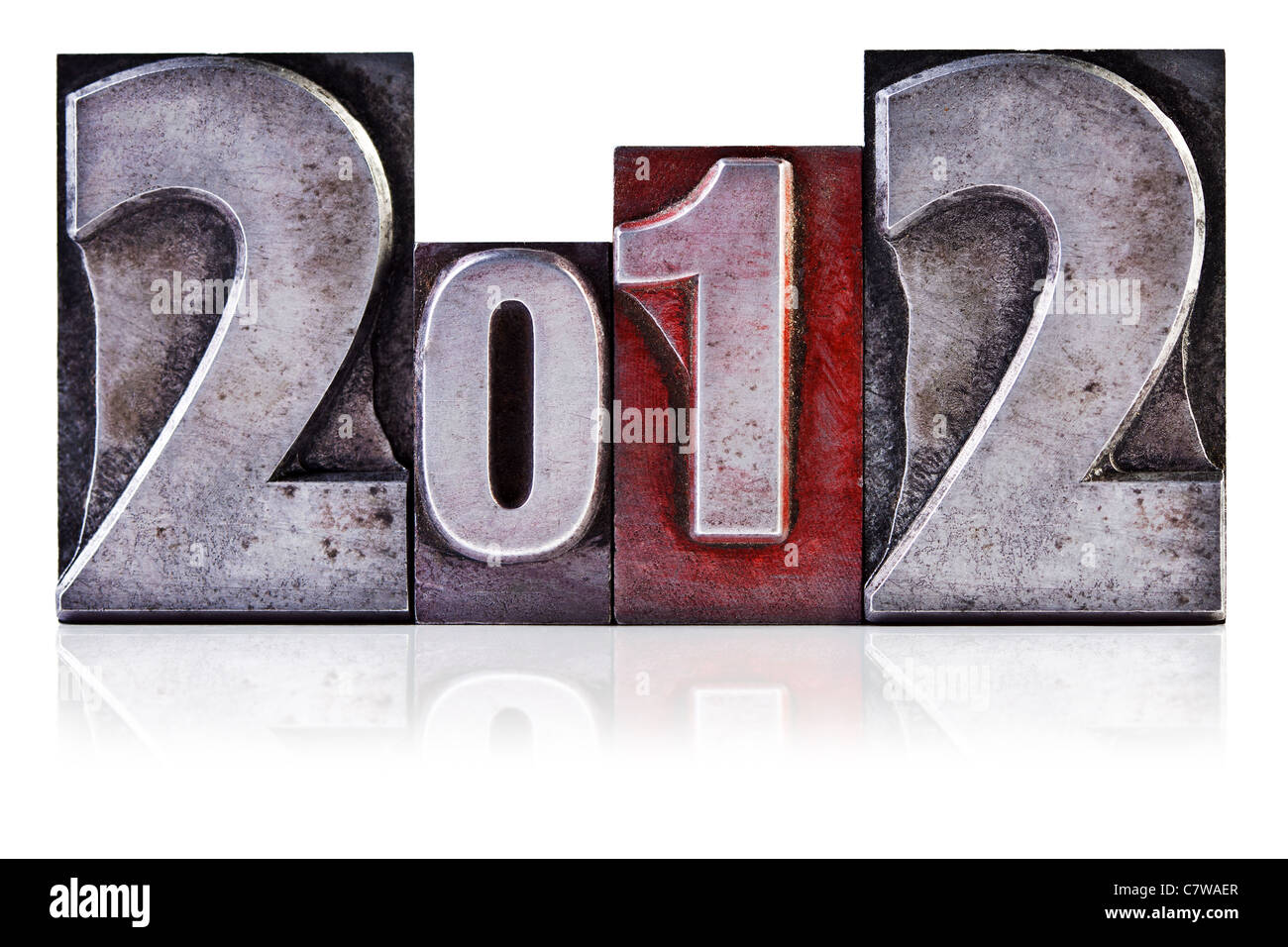 Photo of the number 2012 in old metal letterpress, isolated on a white background. - Stock Image
