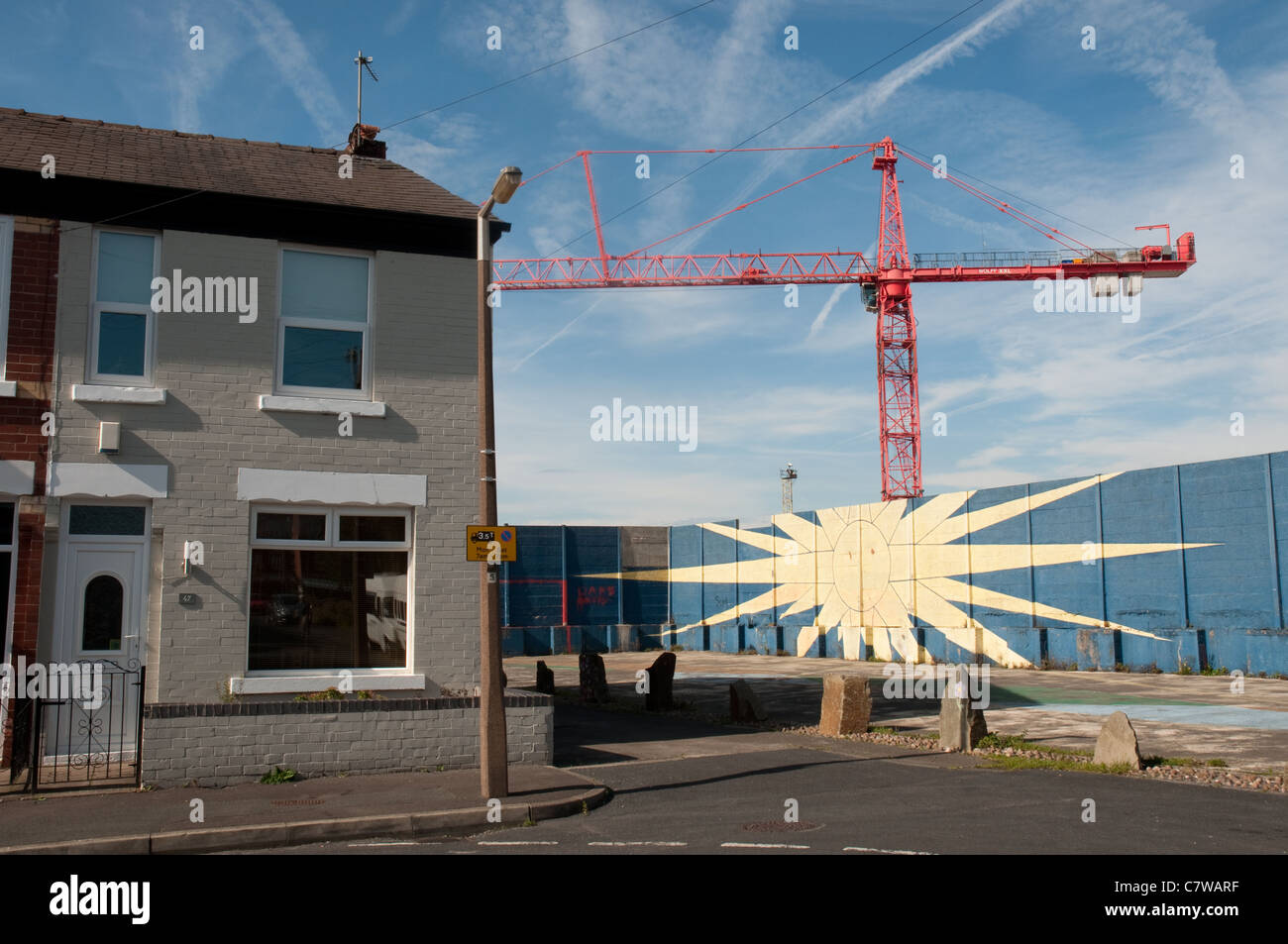 Industry alongside residential property in Reddish,Stockport,Greater Manchester. - Stock Image