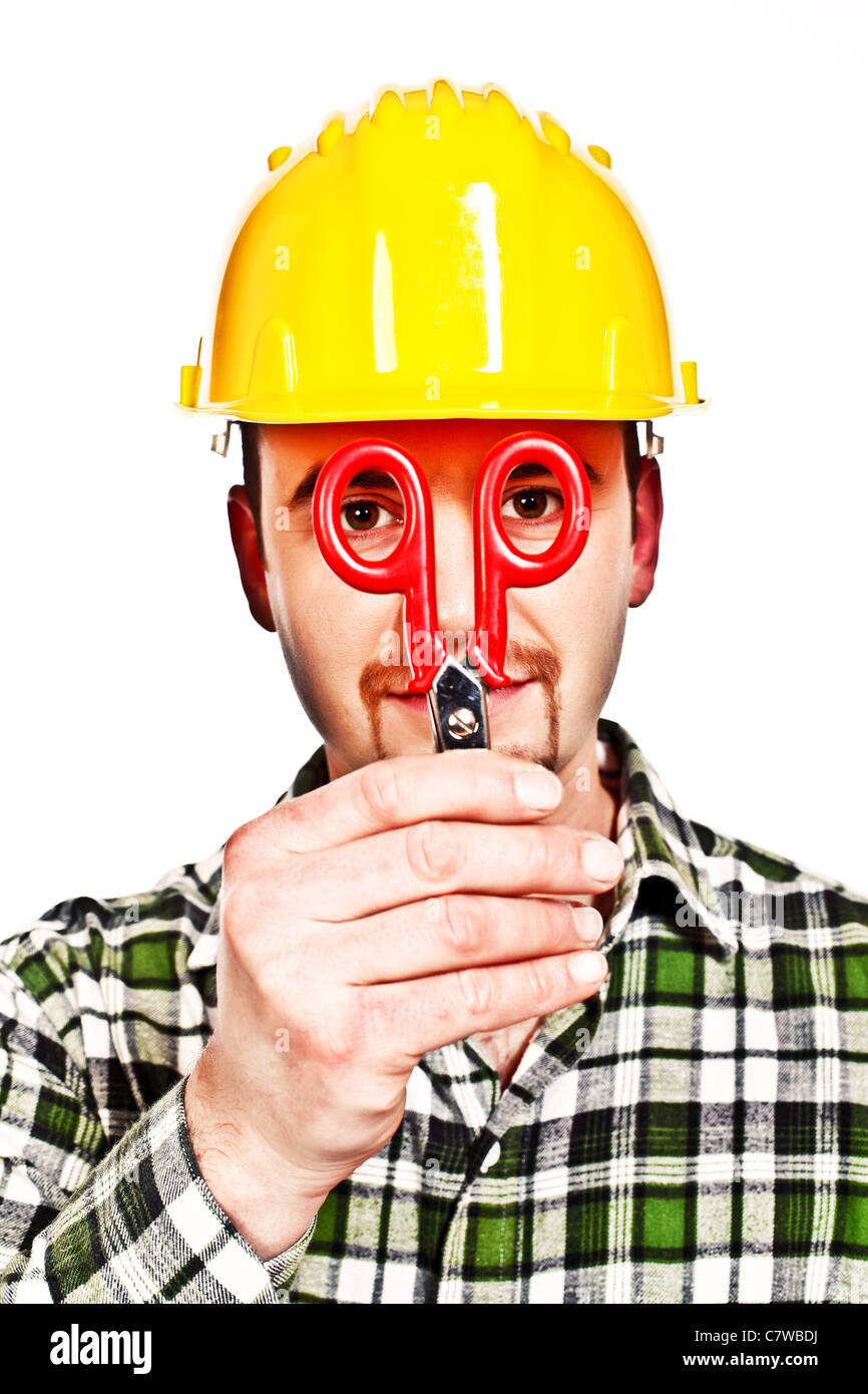 fun portrait of young manual worker joke with his tool - Stock Image