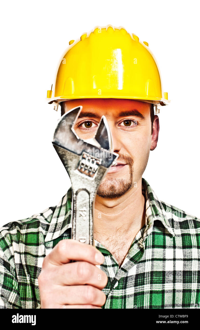 manual worker with classic wrech tool infront of him - Stock Image