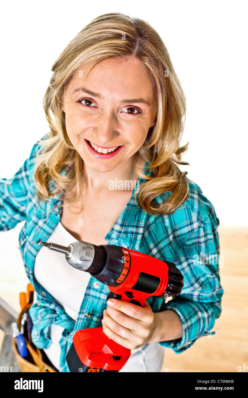 smiling young caucasian woman at work - Stock Image