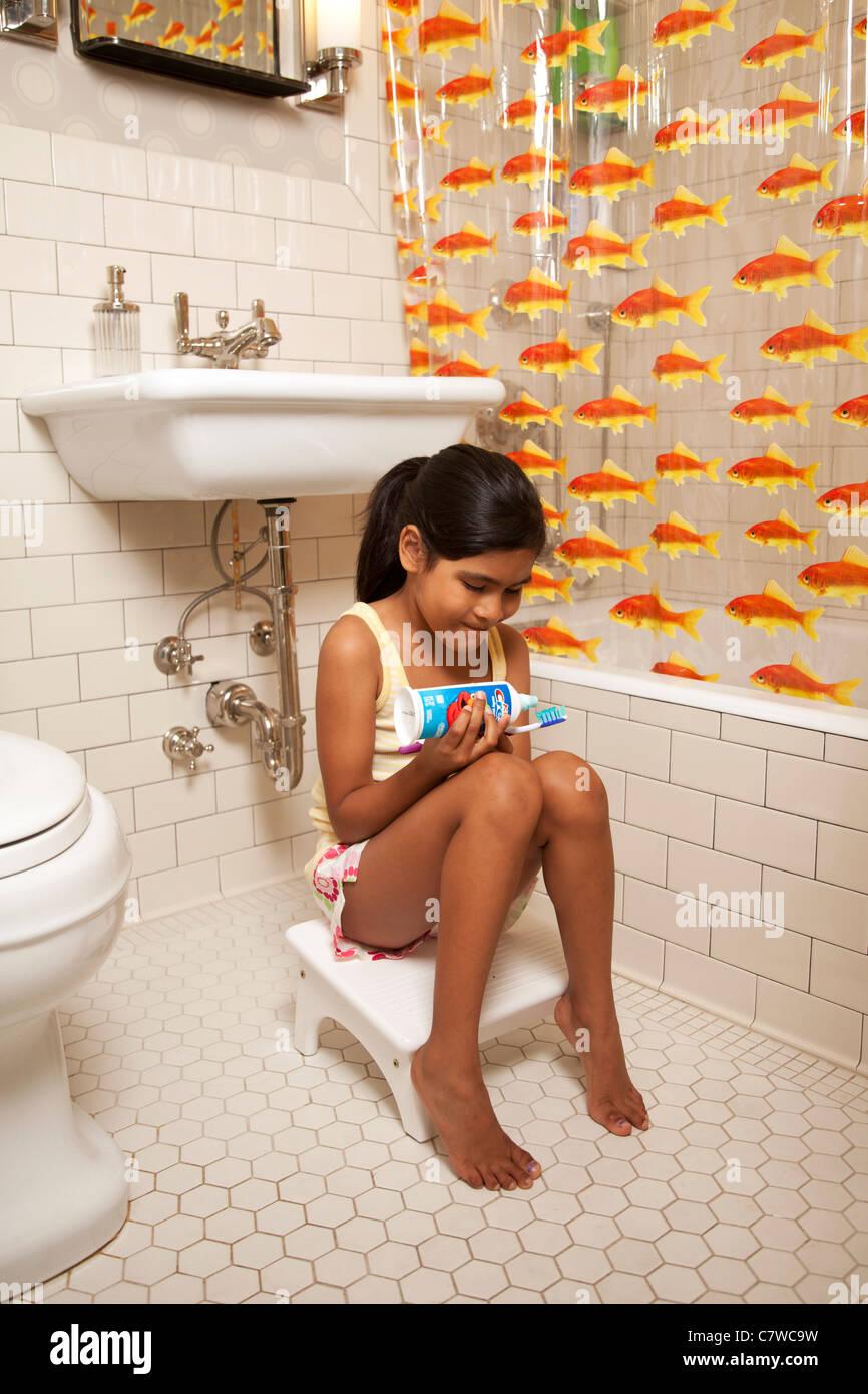 Young Girl In Bathroom Brushing Teeth Stock Photo 39281813