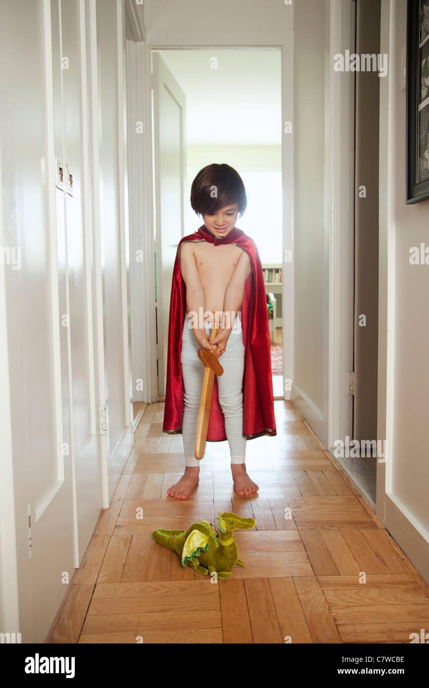 Little boy dressed up in superhero costume - Stock Image
