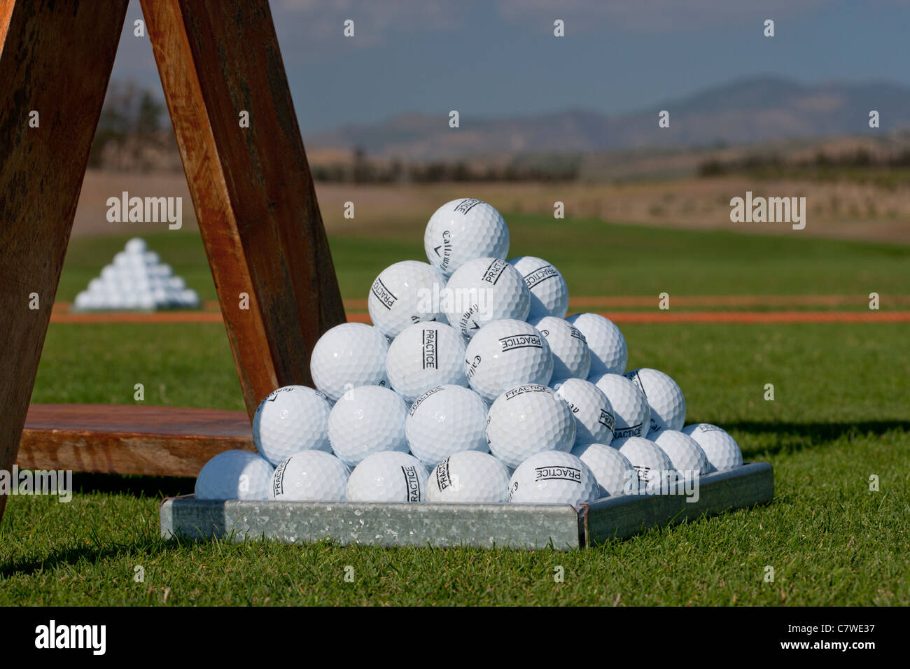 Pyramid of golf balls at a Golf driving practice range Stock Photo