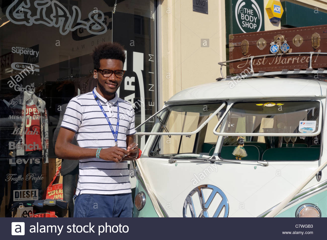 VW split screen camper van being used in a promotion for FIT clothing store, Hereford, England, UK. Samai black - Stock Image