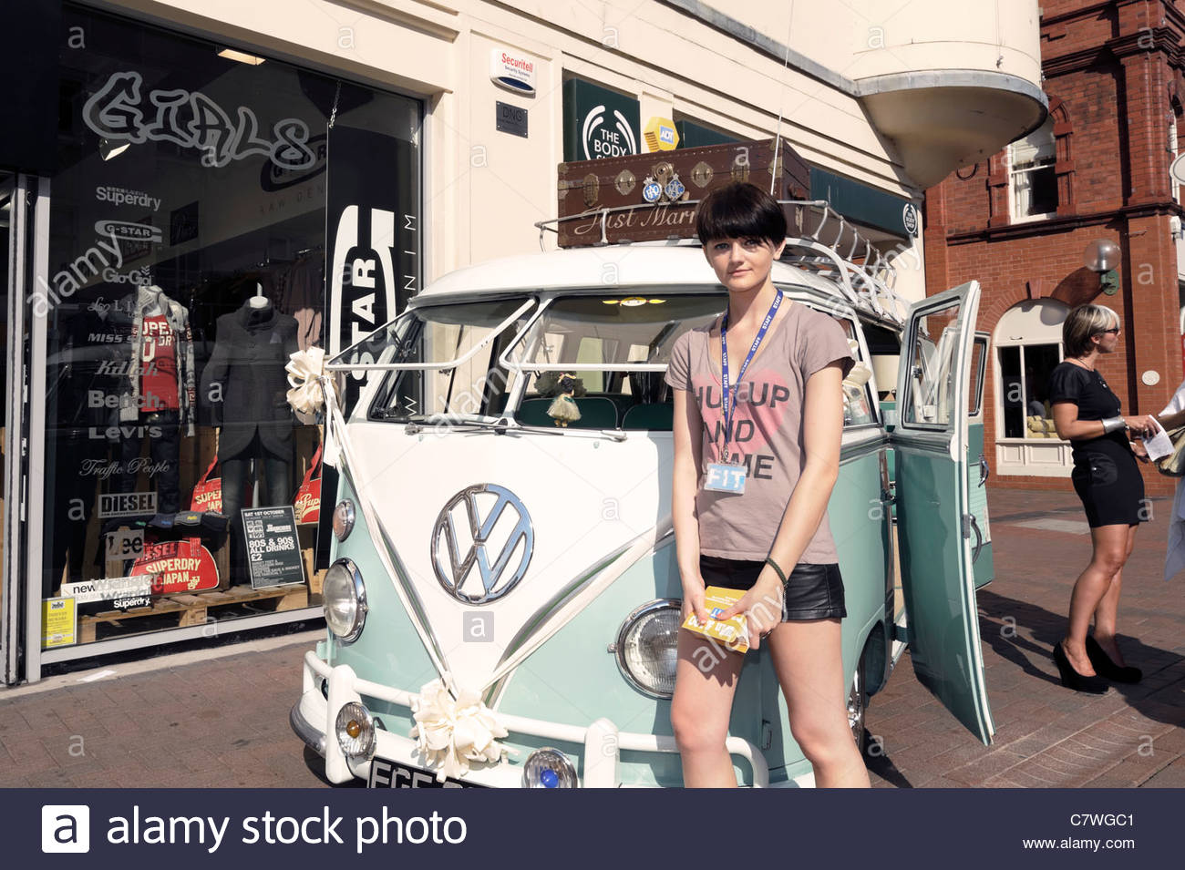 VW split screen camper van being used in a promotion for FIT clothing store, Hereford, England, UK. Emily Jones - Stock Image