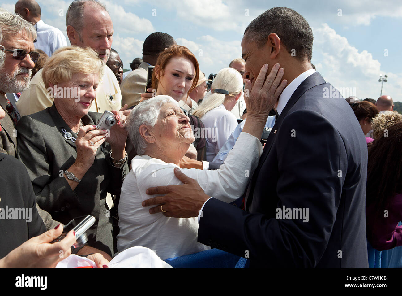 President Barack Obama greets a woman following a ceremony to commemorate the tenth anniversary of the 9/11 attacks - Stock Image