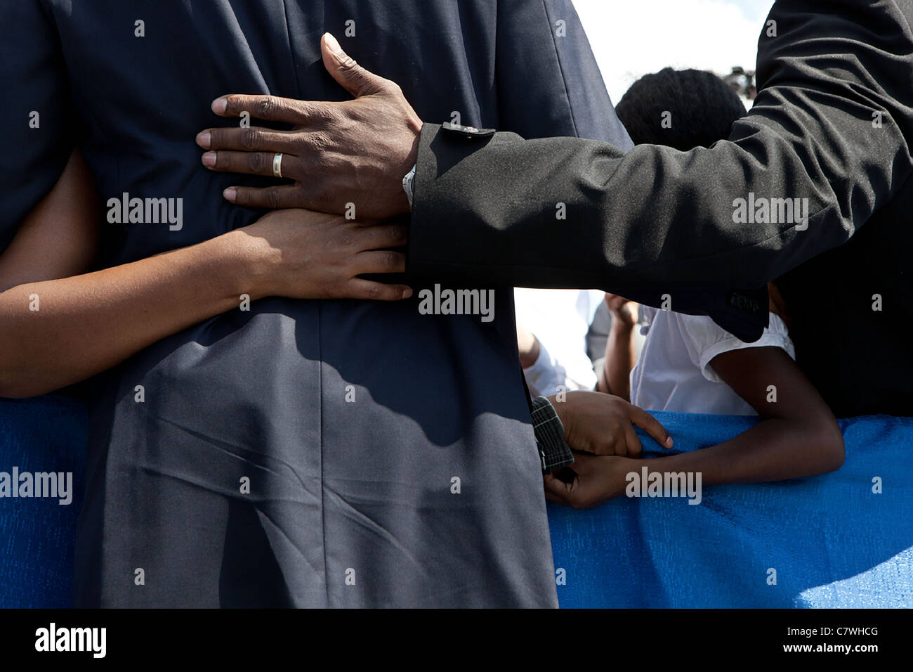 President Barack Obama comforts family members following a ceremony to commemorate the tenth anniversary of the - Stock Image