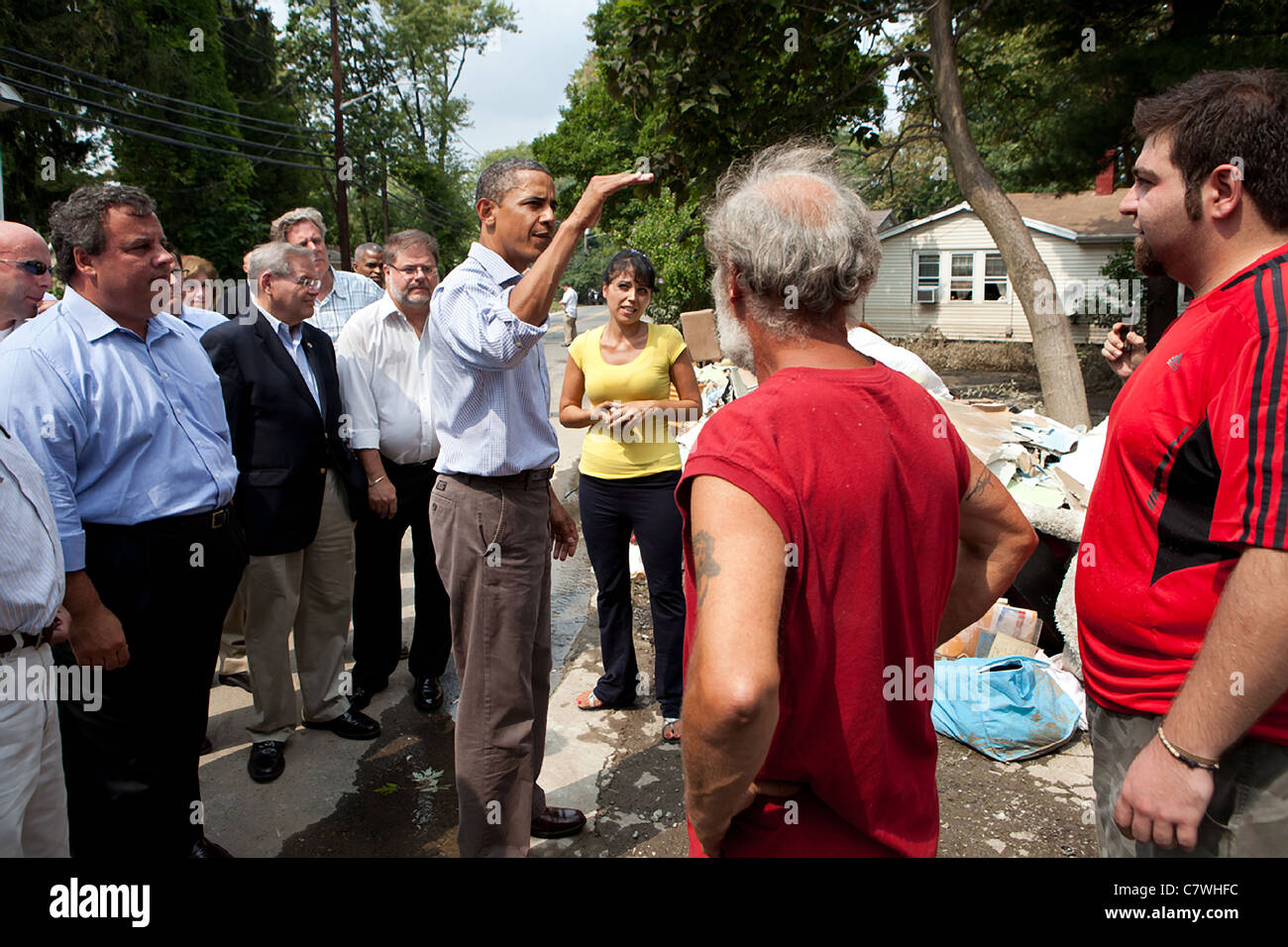 President Barack Obama with New Jersey Governor Chris Christie (L) talks with residents effected by hurricane Irene - Stock Image