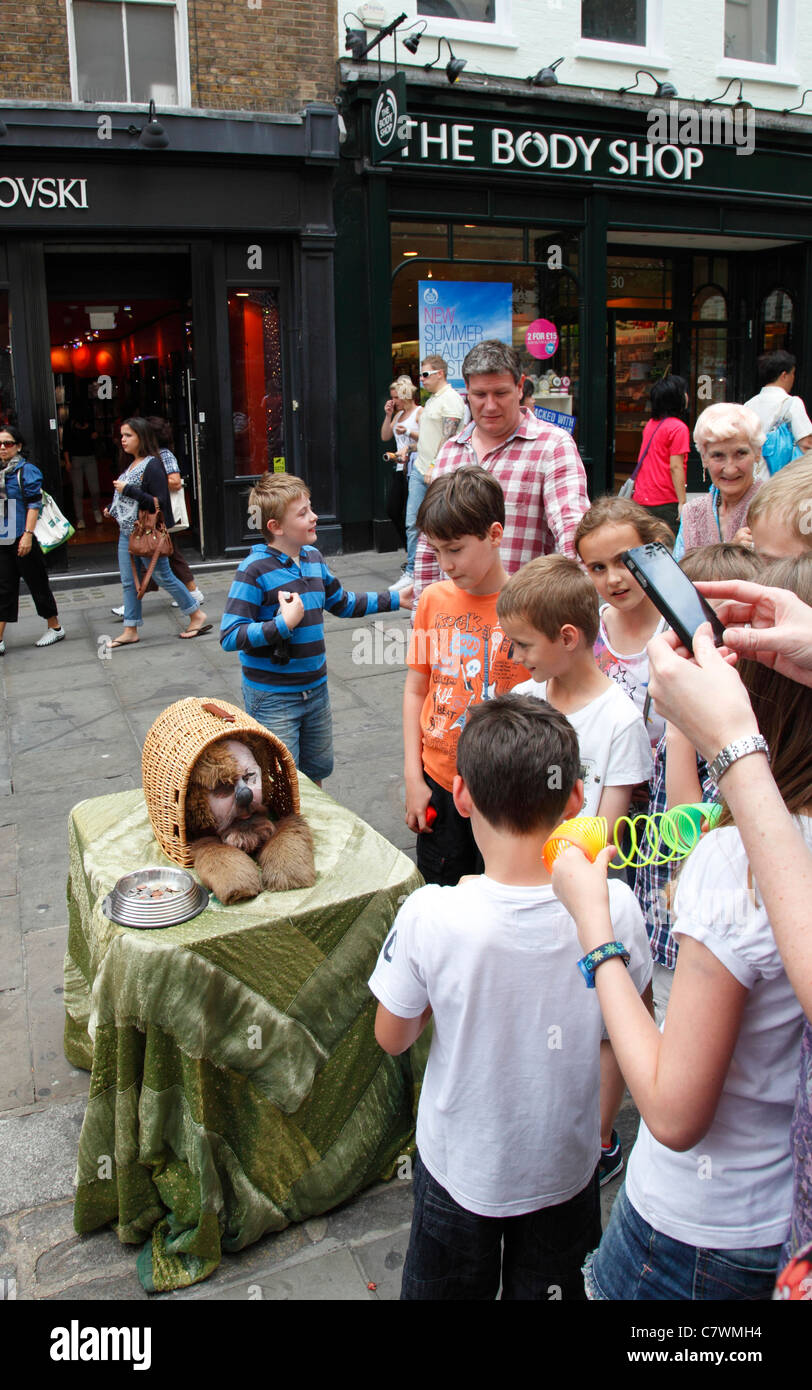 A street entertainer performing in Covent Garden, London, England, U.K. - Stock Image