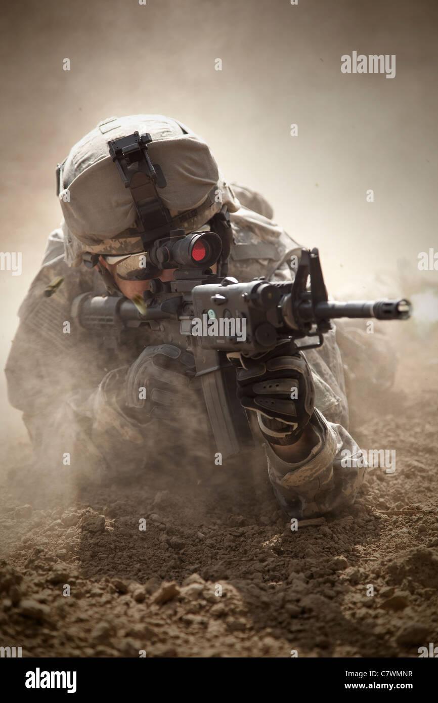 U.S. Army Ranger in Afghanistan combat scene. - Stock Image