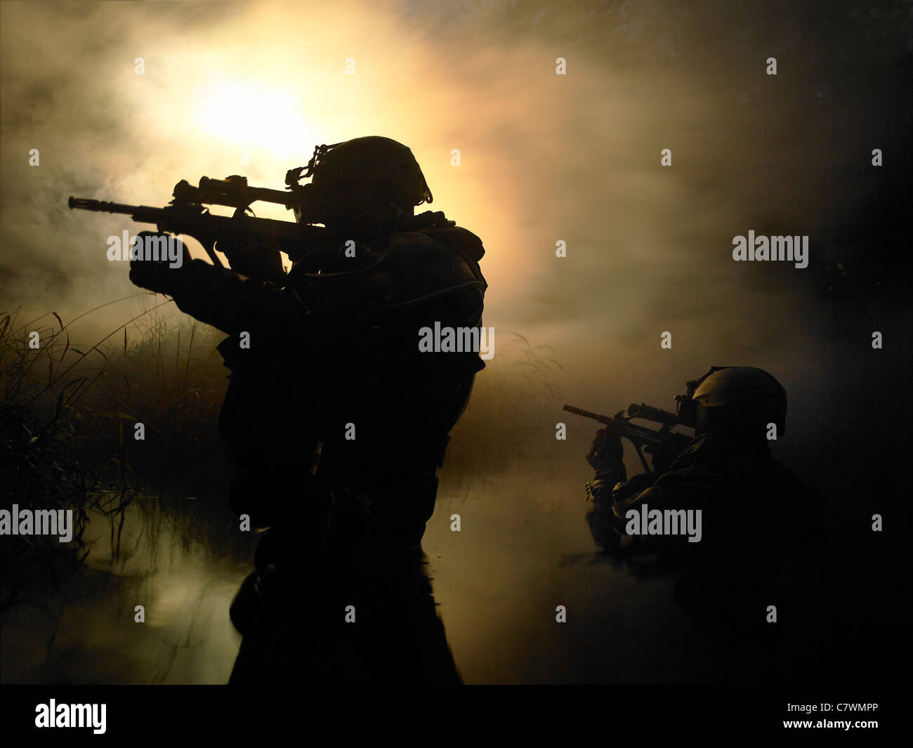 Special Operations Forces combat divers transit the waters armed with Steyr AUG assault rifles. - Stock Image